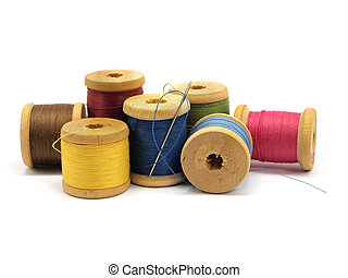 thread and needle on a white background