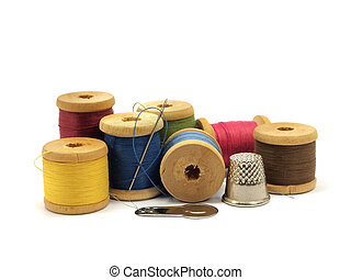 threads, needle and thimble