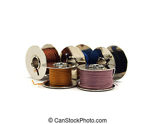 threads spools - Colorful threads spools on white background...