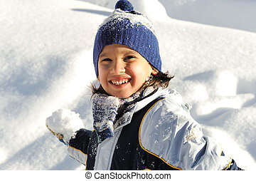 Happy smiling boy throwing snow to you