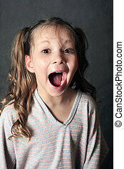 Portrait 5 years girls shouting in studio