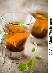 Cup of tea - Cup of hot tea with fresh mint leaves