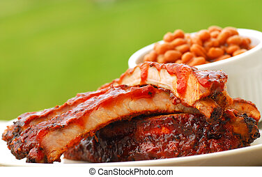 BBQ Ribs and beans - Freshly grilled BBQ Ribs and beans in...