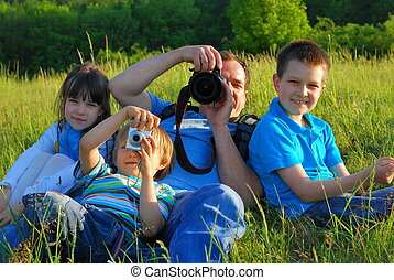 family photography outing - father and three children...