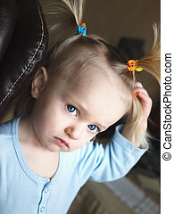 Baby girl with tails on head - Bewilderment baby girl with...