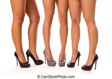 High Heeled Legs - Close up of three womens legs in high...