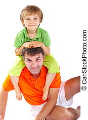 Bonding - A young boy bonds with his fatheruncle, perched...