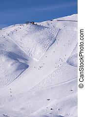 ski slope in austrian alps - Ski slope with people skiing...