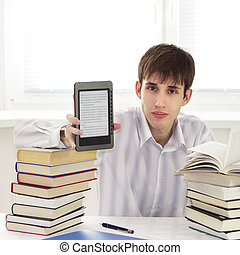 Student with ebook reader on a light background