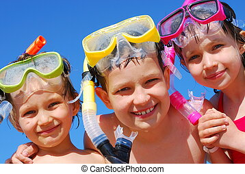 Kids ready for swimming - A close up view of three children...