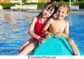 Brother and sister in pool