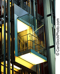 modern elevator construction in glass and steel