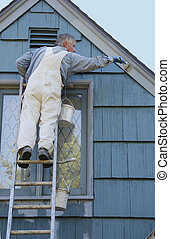 Man painting house - Professional painter painting house