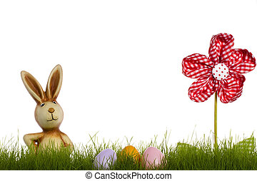 easter bunny behind grass with drapery flower and easter eggs on white background