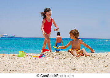 Children playing on beach - A view of children playing in...