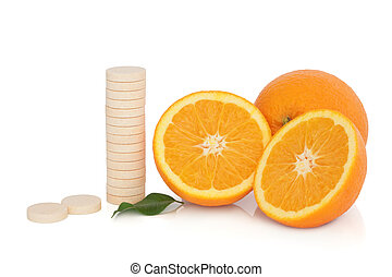 Cold Remedy - Vitamin c tablet stack with orange fruit whole...