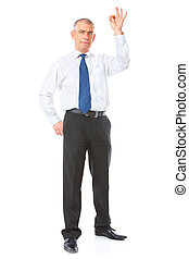 Cheerful businessman with ok sign - Happy mature businessman...