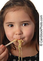 Young girl eating noodle soup - Pretty young girl eating...