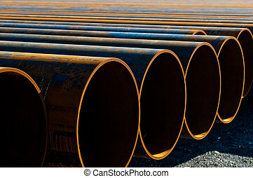 Metal pipes laid out in storage