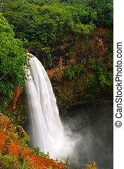 Wailua falls in Kauai Hawaii - Dramatic view of Wailua Falls...