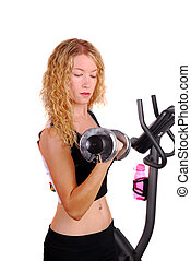 Attractive woman working out with a dumb bell - Attractive...