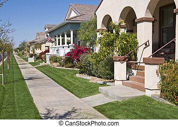 Housing development in Arizona - Lawn mowing day in housing...