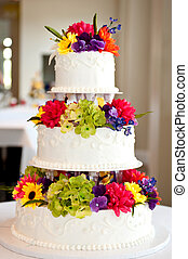 wedding cake with flowers on table