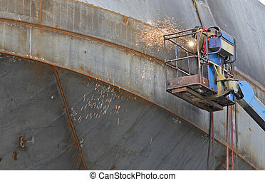 Welder at shipyard