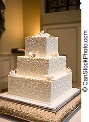 Wedding Cake - White wedding cake with flowers on a silver...