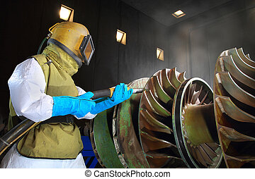 sandblasting - A worker working in a sandblast workshop