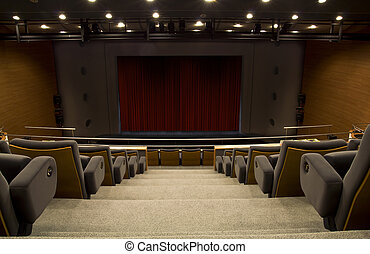 a stage of a auditorium with a closed curtain