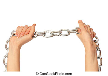 symbol of captivity - woman breaking the chain by hands for...