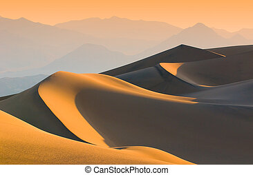 sand dunes over sunrise sky