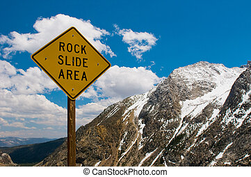 Rock slide area sign in the mountains