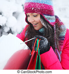 winter shopping - winter girl with gift bags on snow...