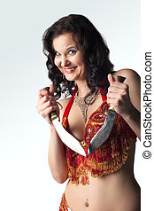 Insane woman with knife smile - Insane smiling woman in...