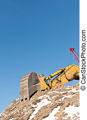 Hydraulic Excavator in Winter - The arm and bucket of a...