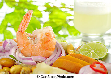 Peruvian prawn ceviche with the cocktail pisco sour in the...