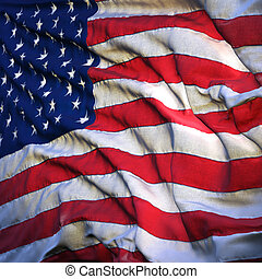Flag of the United States, fluttering in the breeze, backlit ris