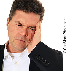Headache - Attractive middle-aged man suffering from...