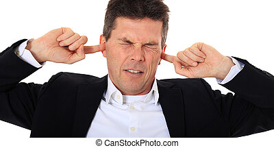Noise - Attractive middle-aged man suffering from tinnitus....