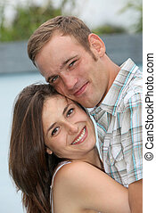 amorous young couple entwined - a young amorous young couple...