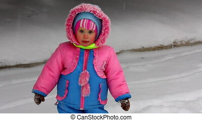 baby girl walking in winter park