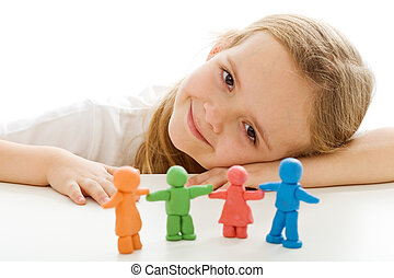 Happy little girl with her colorful clay people