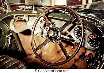 classic car - grunge effect classic car steering wheel and...