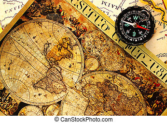 Old paper world map - Old paper world map and a compass,...