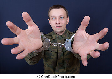 Release me - Portrait of the man with handcuffs on hands