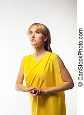 Blond woman in yellow veil artist role
