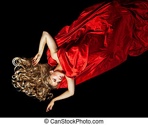 Blond woman in red with gold hair