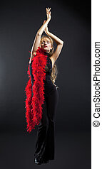 Blond woman dance with red boa